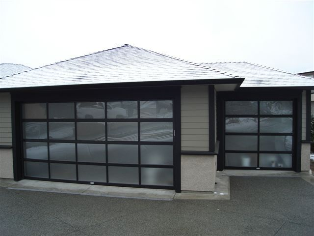 This is a style of garage door I've never considered before. It gives the same privacy as a traditional garage door. One added bonus is that it would let a lot of light in as well. I'll have to look into it more.