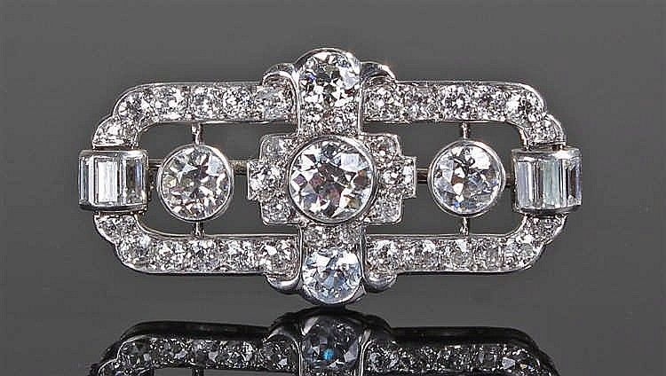 Impressive diamond brooch, the white metal mount set with round and baguette…