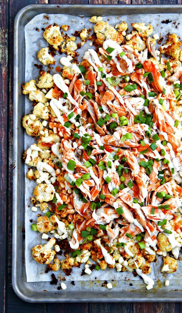"Buffalo Ranch Roasted Cauliflower ""Nachos"" - Roasted cauliflower with ranch dressing, fresh corn, shredded chicken and a hearty drizzle of buffalo sauce and a little more ranch. Get your veggies the delicious way! You can also make the Ranch Roasted Cauliflower on its own - so good! #ad @HVRanch"