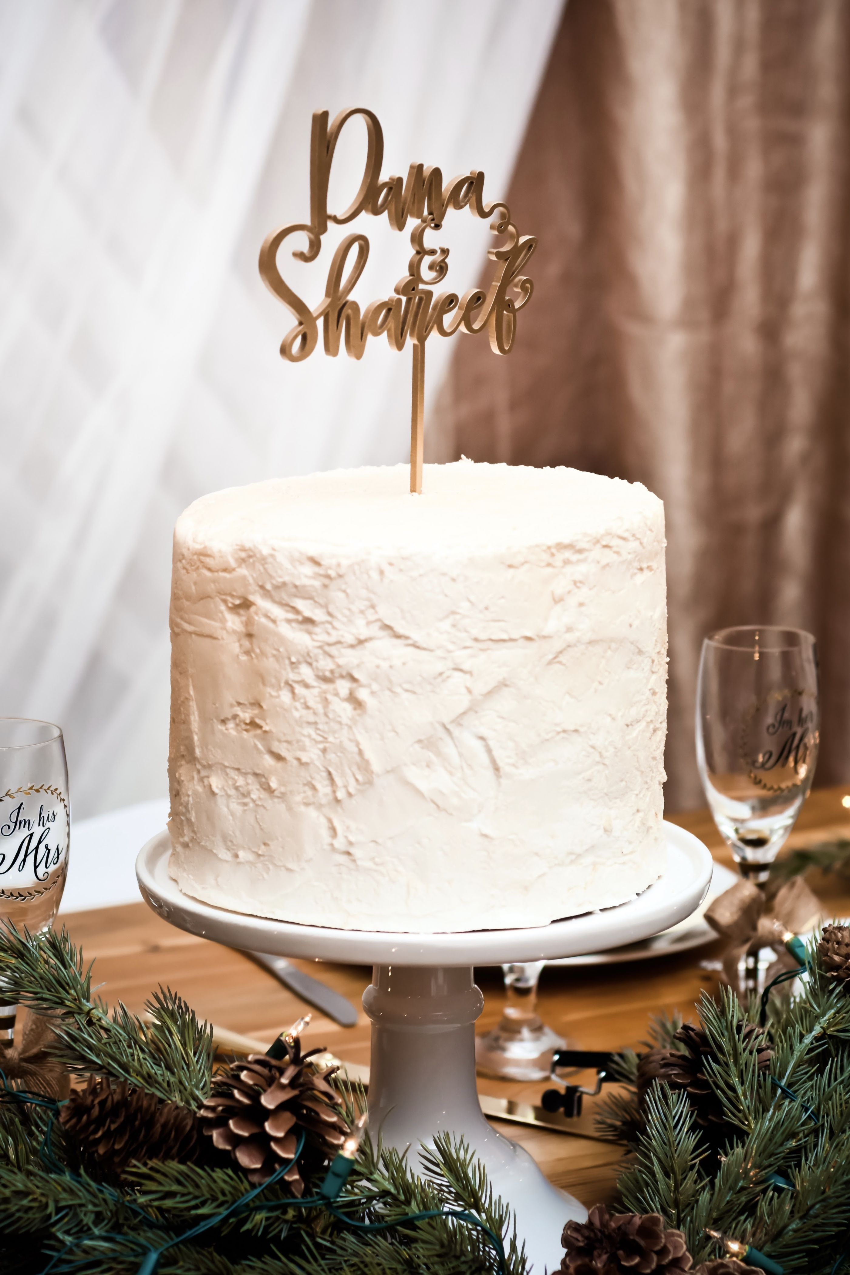 A textured, white wedding cake is simple yet very elegant