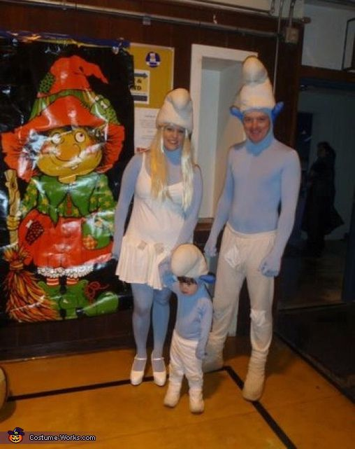 Baby smurf with parents halloween costume contest at costume works nona myself my husband and my 25 year old were a trio of smurfs in douglas alaska this year solutioingenieria Images