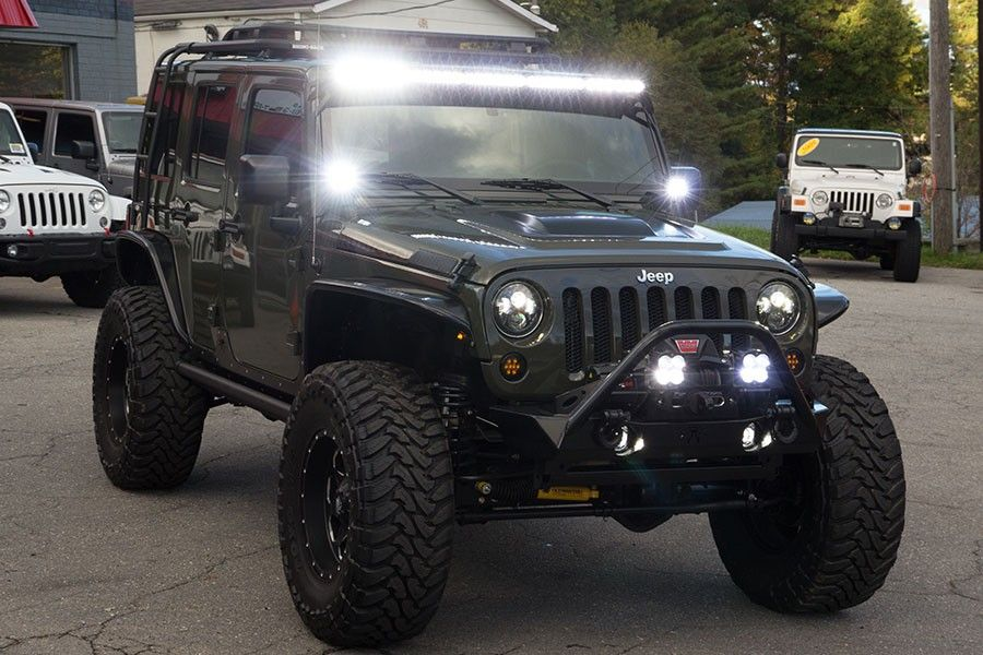 Custom 2015 Jeep Wrangler Unlimited Rubicon Tank - Baja Designs Lights On
