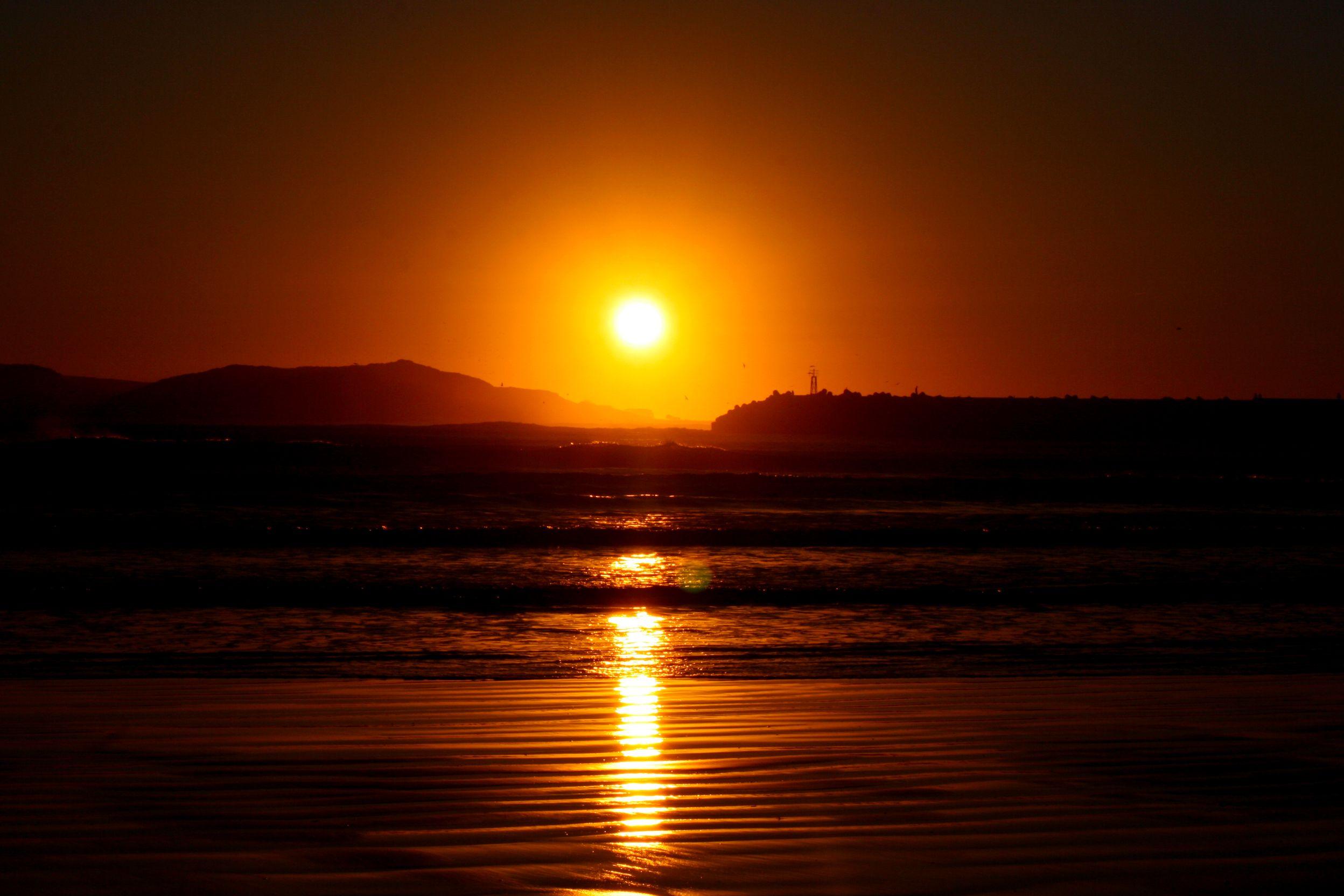 Sunset over Essaouira beach by Nicole Rossetti le Strange