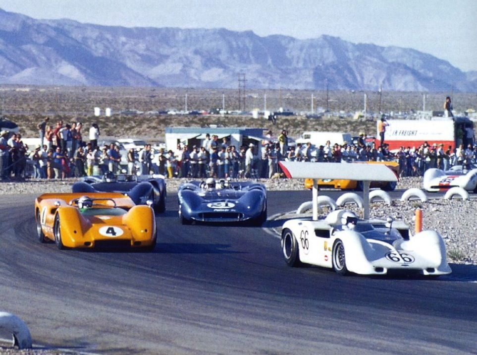 (66) Jim Hall - Chaparral 2G Chevrolet - Chaparral Cars - (4) Bruce McLaren - McLaren M6A Chevrolet - McLaren Cars Ltd. - (21) Parnelli Jones - Lola T70 Mk.III Ford - American Rubber Plastic Corp. George Bignotti Racing - Can-am Las Vegas 1967. Jim Hall in his no.66 Chapparal leads Bruce McLaren in his McLaren M6A. - Third Annual Stardust Grand Prix 1967 - Canadian-American Challenge Cup, round 6
