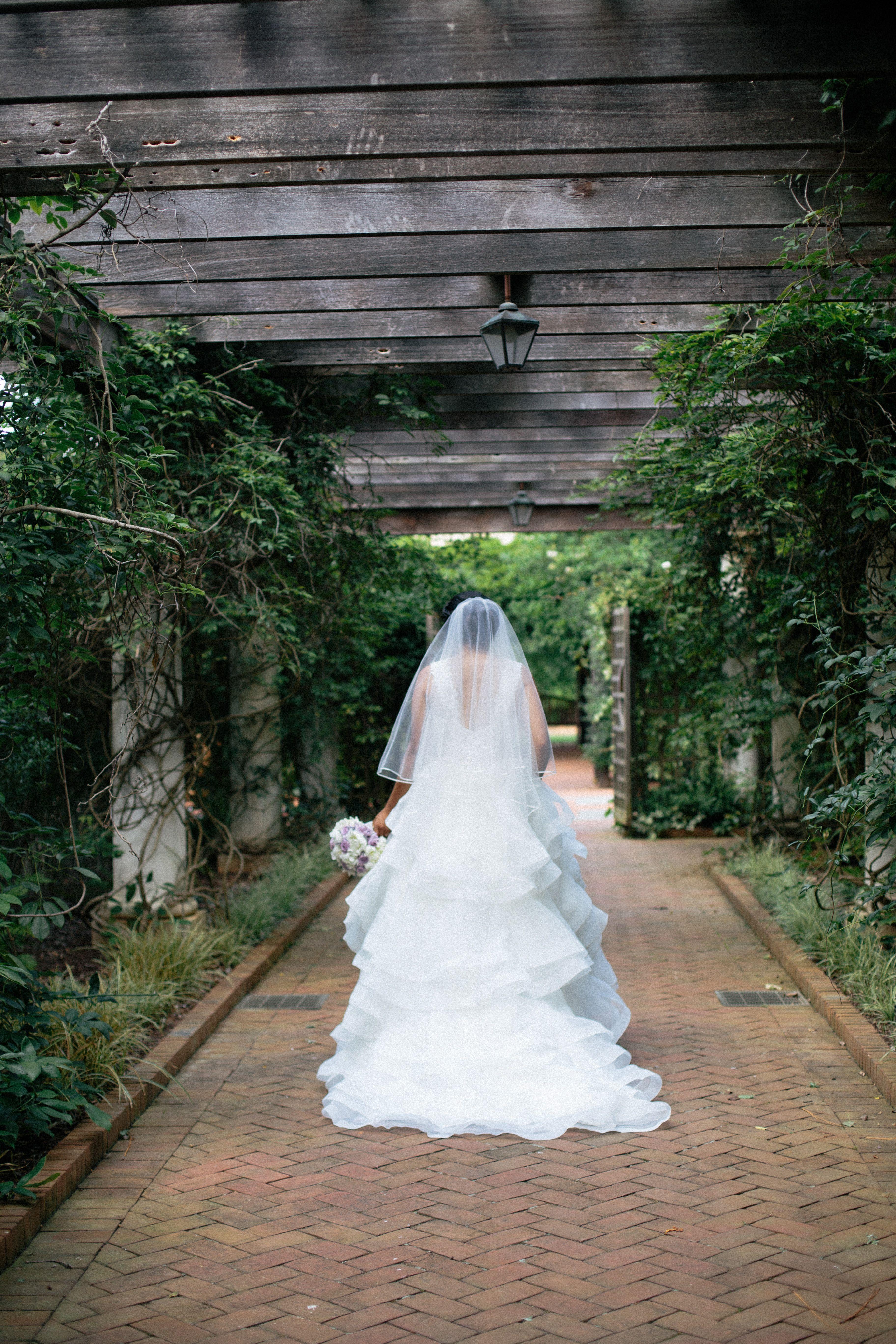 Garden wedding photo shoot wedding dress ideas long tail wedding