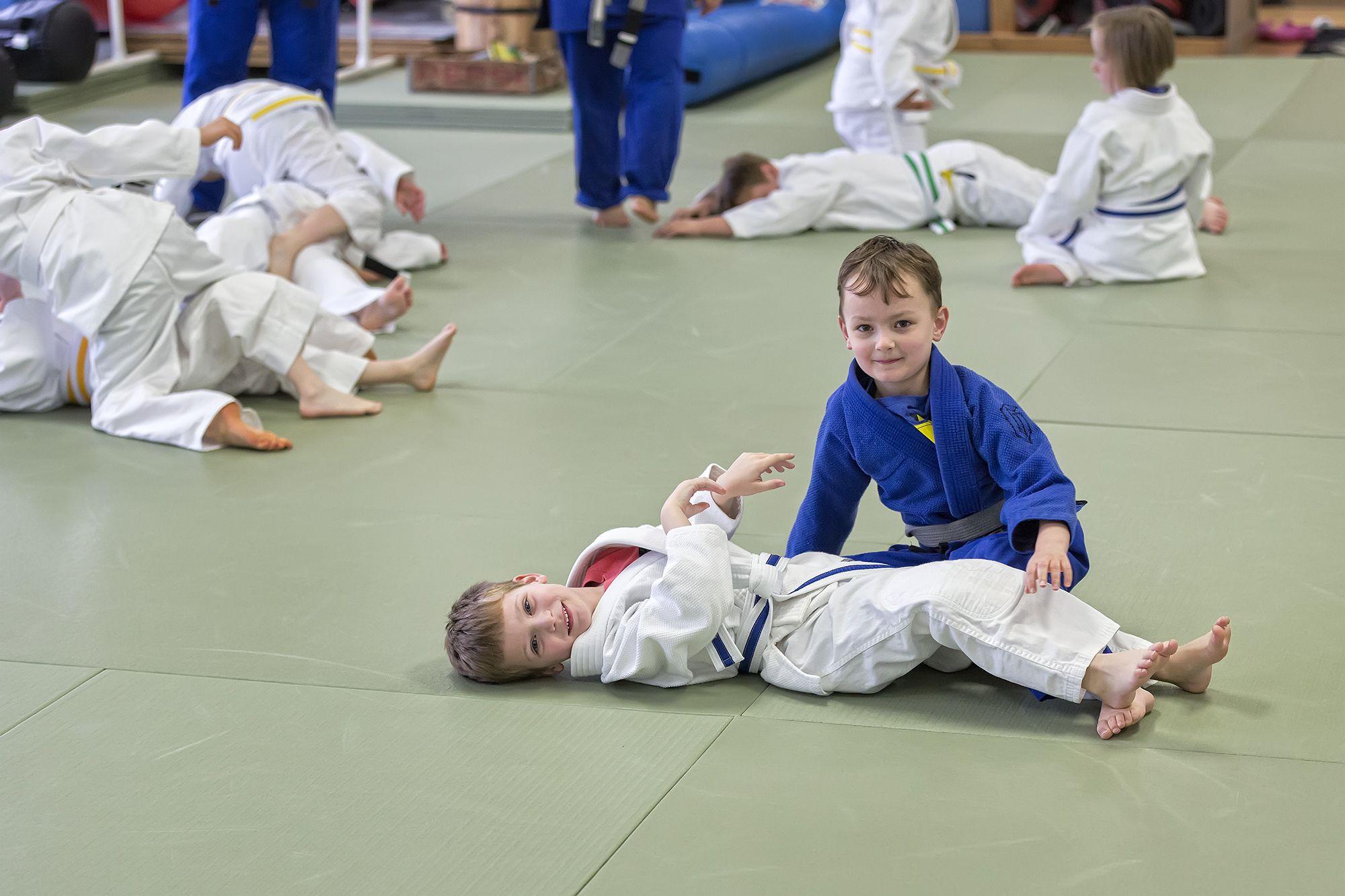 Kids who train brazilian jiu jitsu at revolution mma in