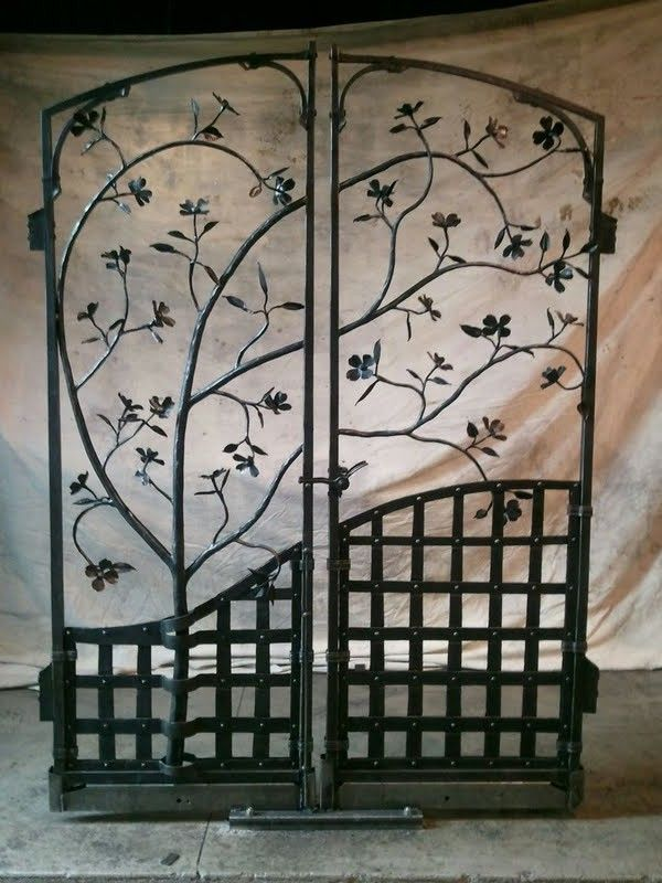 Iron gate featuring dogwood flowers. See more at essentialcraftsman.com
