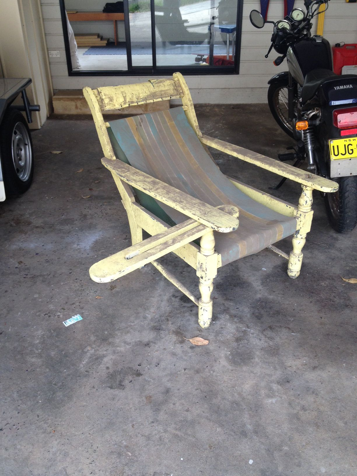 Dusty Old Squatters Chair from a garage sale before clean up and