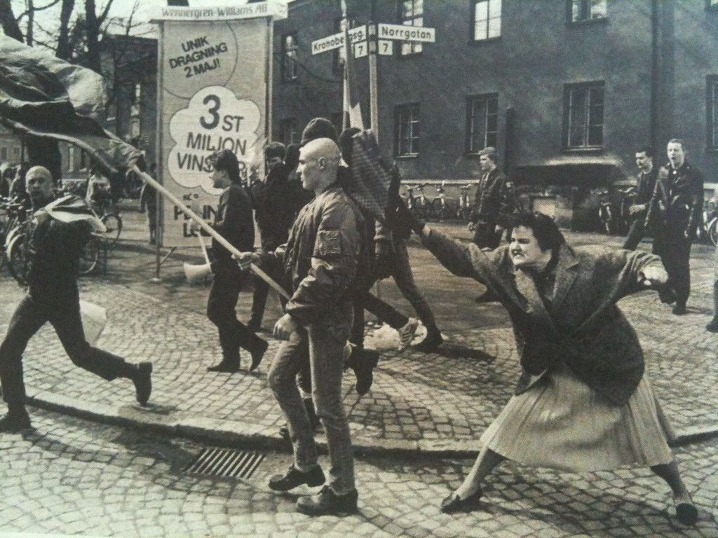 A Swedish woman who allegedly survived a concentration camp bonks a skinhead with her purse during a Neo-nazi demonstration, 1985.  (for wider perspective: http://qph.is.quoracdn.net/main-qimg-9cdf8229bc57ed3da7b6b1b734e26544?convert_to_webp=true)