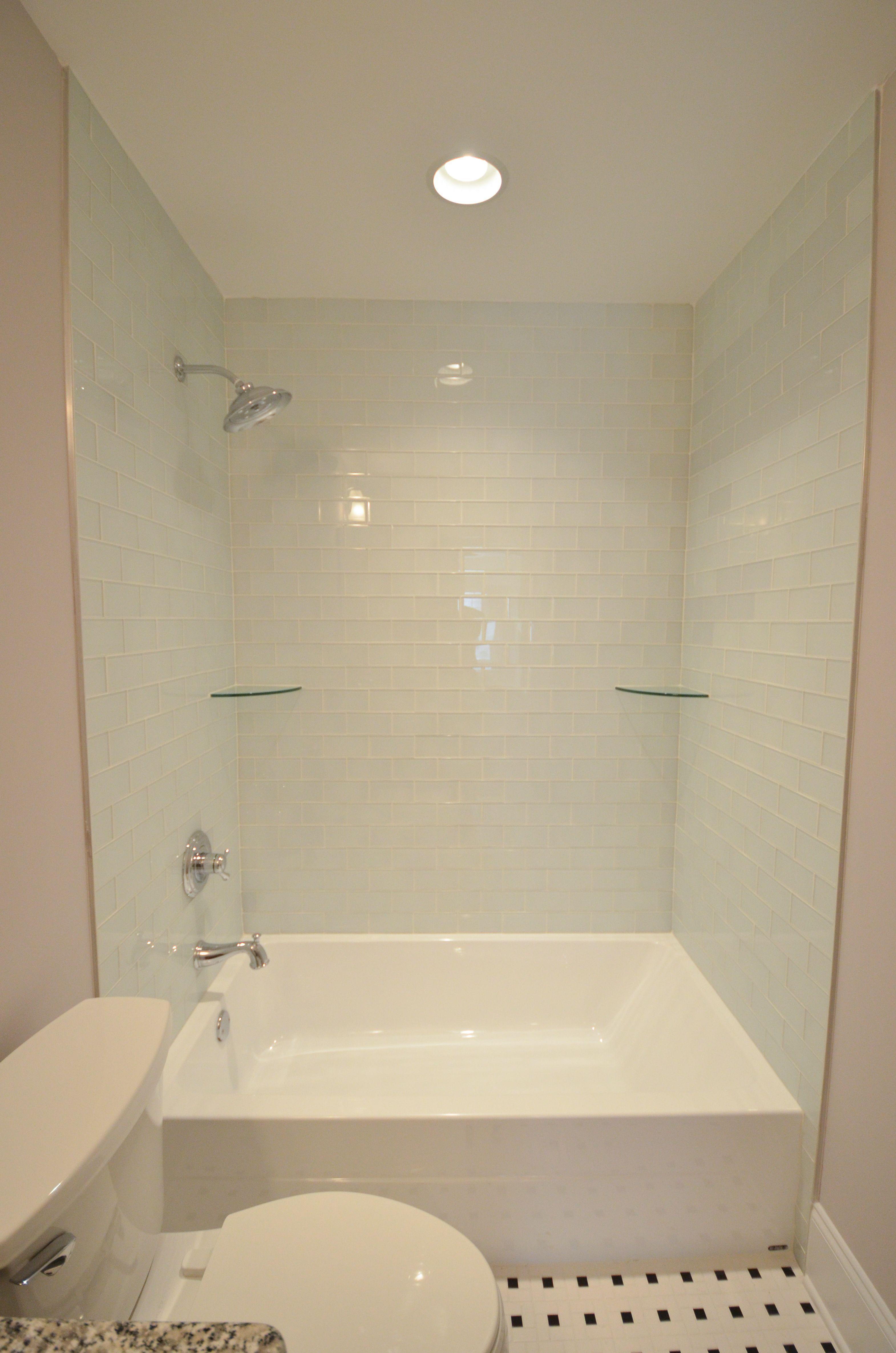 Oversized Tub Shower Combo With Light Blue Tile Shower Shelves
