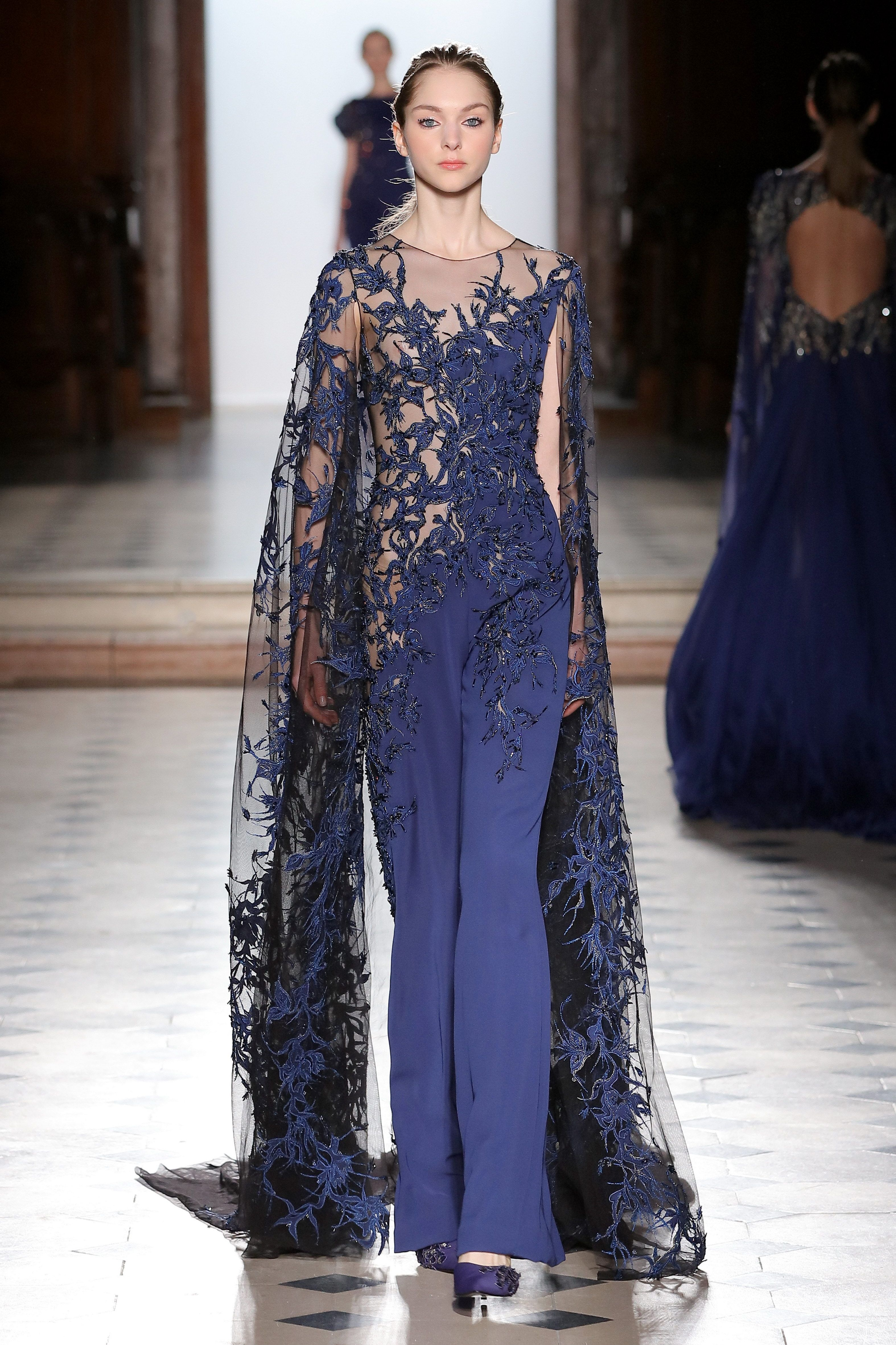 3725271d7aa Tony Ward Couture I Spring Summer 2018 I Navy blue jumpsuit with a sheer  silk embroidered bust and floor-length sleeves.