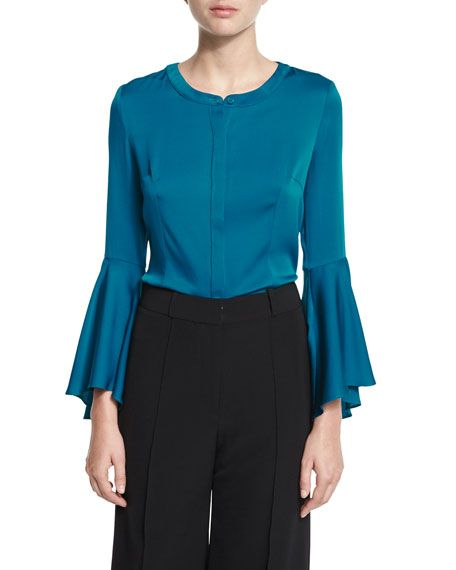 Teal blue blouse, black pants