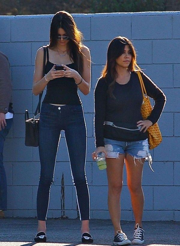 1741a555330 Kourtney Kardashian in Levis Shorts   Kendall Jenner in 3x1 Skinny Jeans