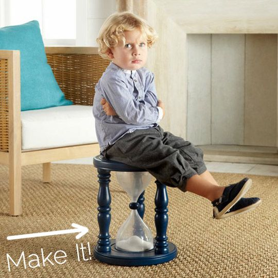 Time out stool with hourglass timer: two liter bottles, a wooden bead, and a stool