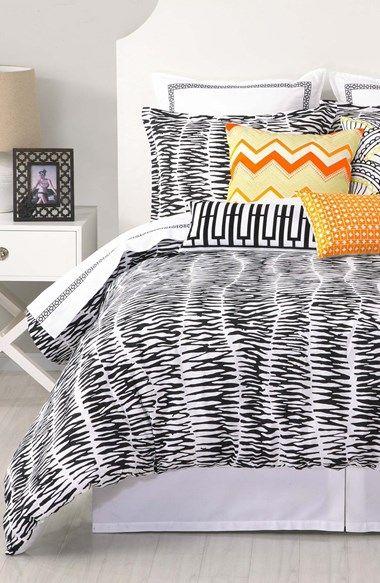 Fun bedding! Love the pop of orange against the zebra print.