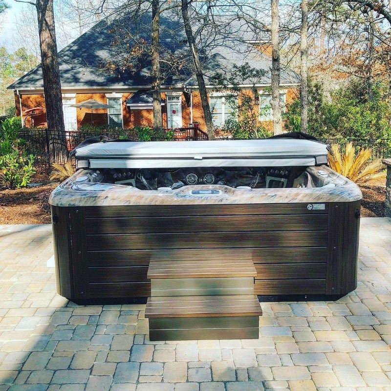 Backyard hot tubs that inspire us | Backyard Retreat in ...