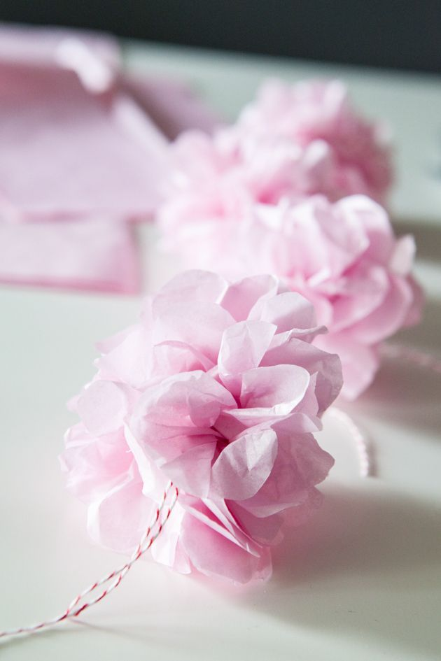 Create these pretty pink tissue pom poms and make them into a ...