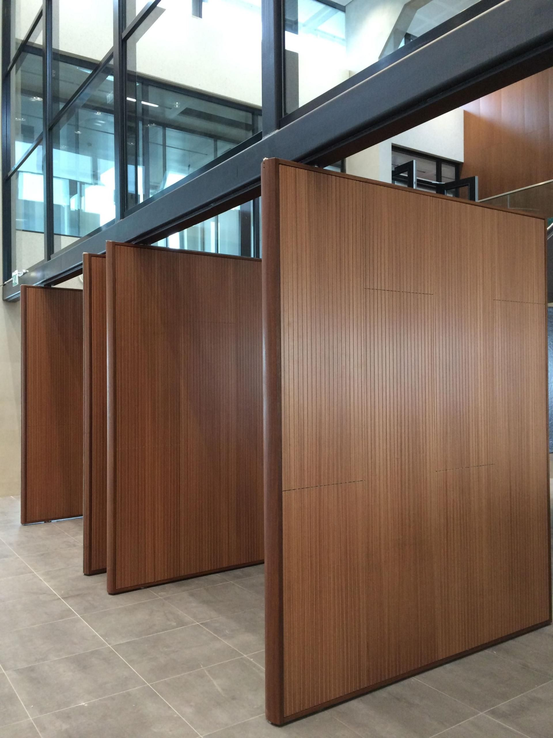 Four Large Wooden Pivotdoors Designed With Soundproof