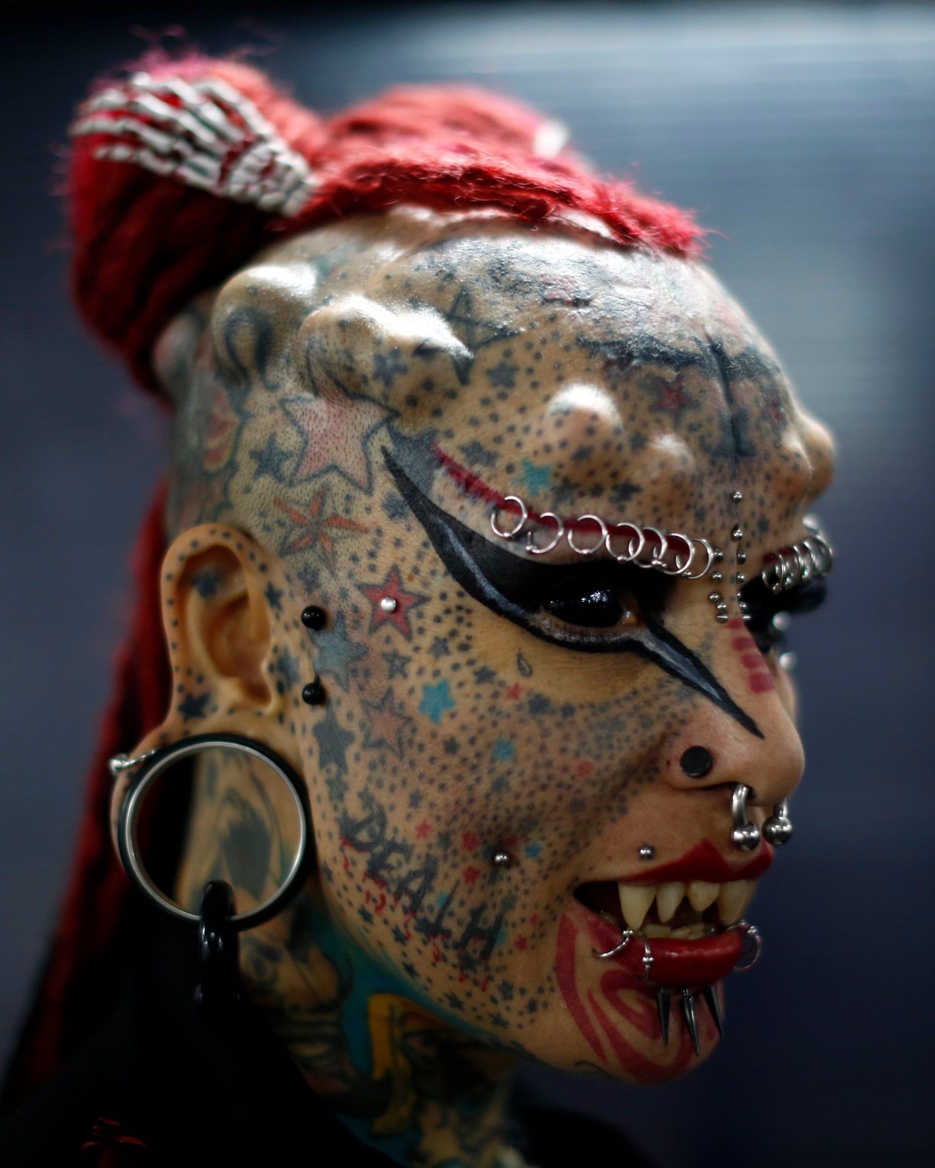 Forked tongues and tattooed eyeballs should body