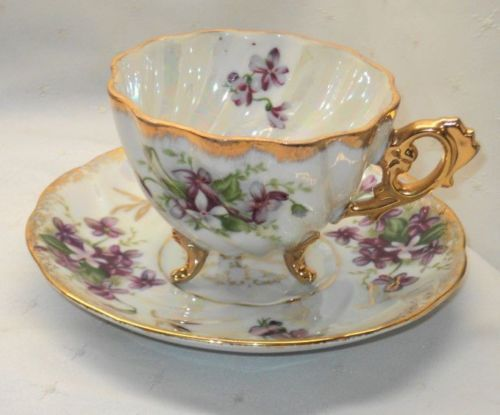 ANTIQUE MADE IN JAPAN 3 FOOTED VIOLETS TEA CUP AND SAUCER