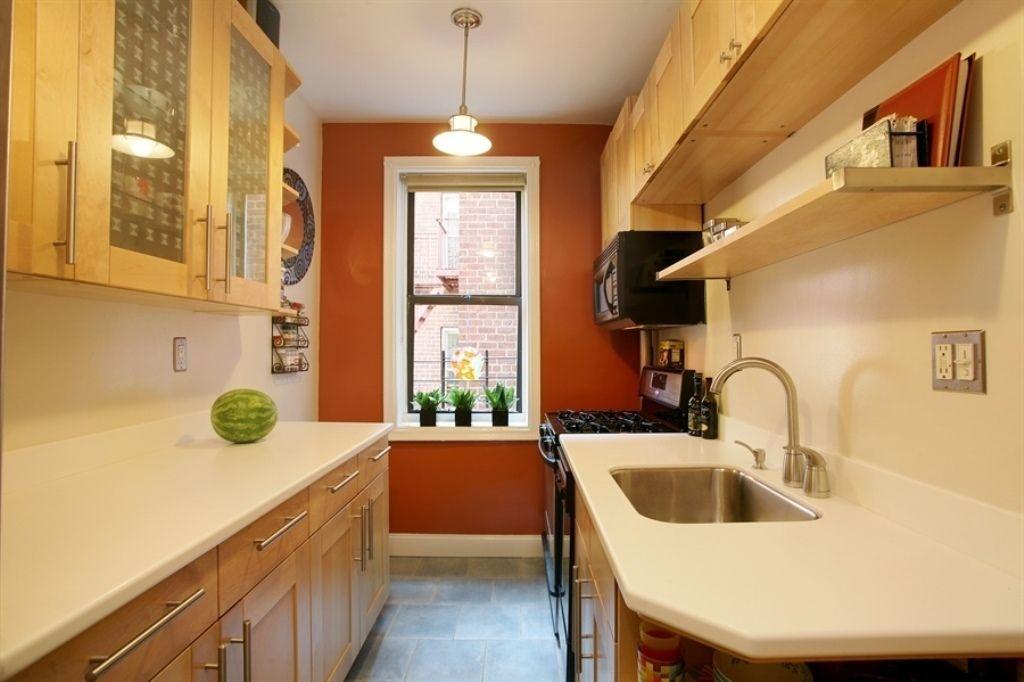 Sienna walls + blond wood cabinets + gray tile floor ...