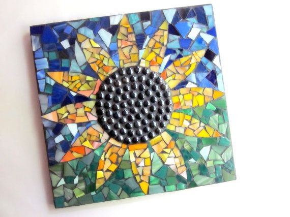 "Glass Mosaic.    Original Contemporary Sunflower Design by Artist Shawn DuBois.    Measures: 12"" x 12"" Square    Base is wood board.    Hanging wire has been attached to the back for immediate display.  Made by Shawn Dubois. $48"