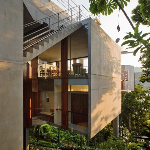 steep slope home designs | floating tropical house design on a