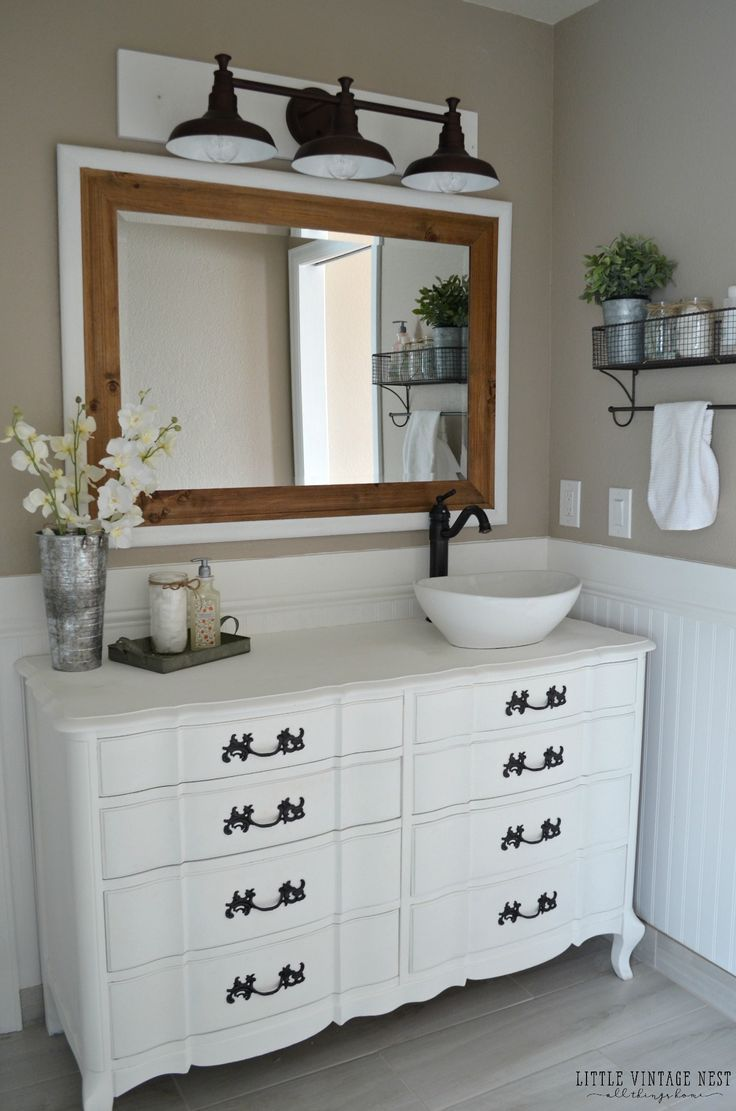 The Art Gallery Farmhouse Bathroom Vanity and Farmhouse Light