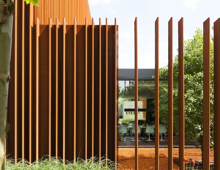 Rusted steel fins define the interior and exterior of the - Interior and exterior design definition ...