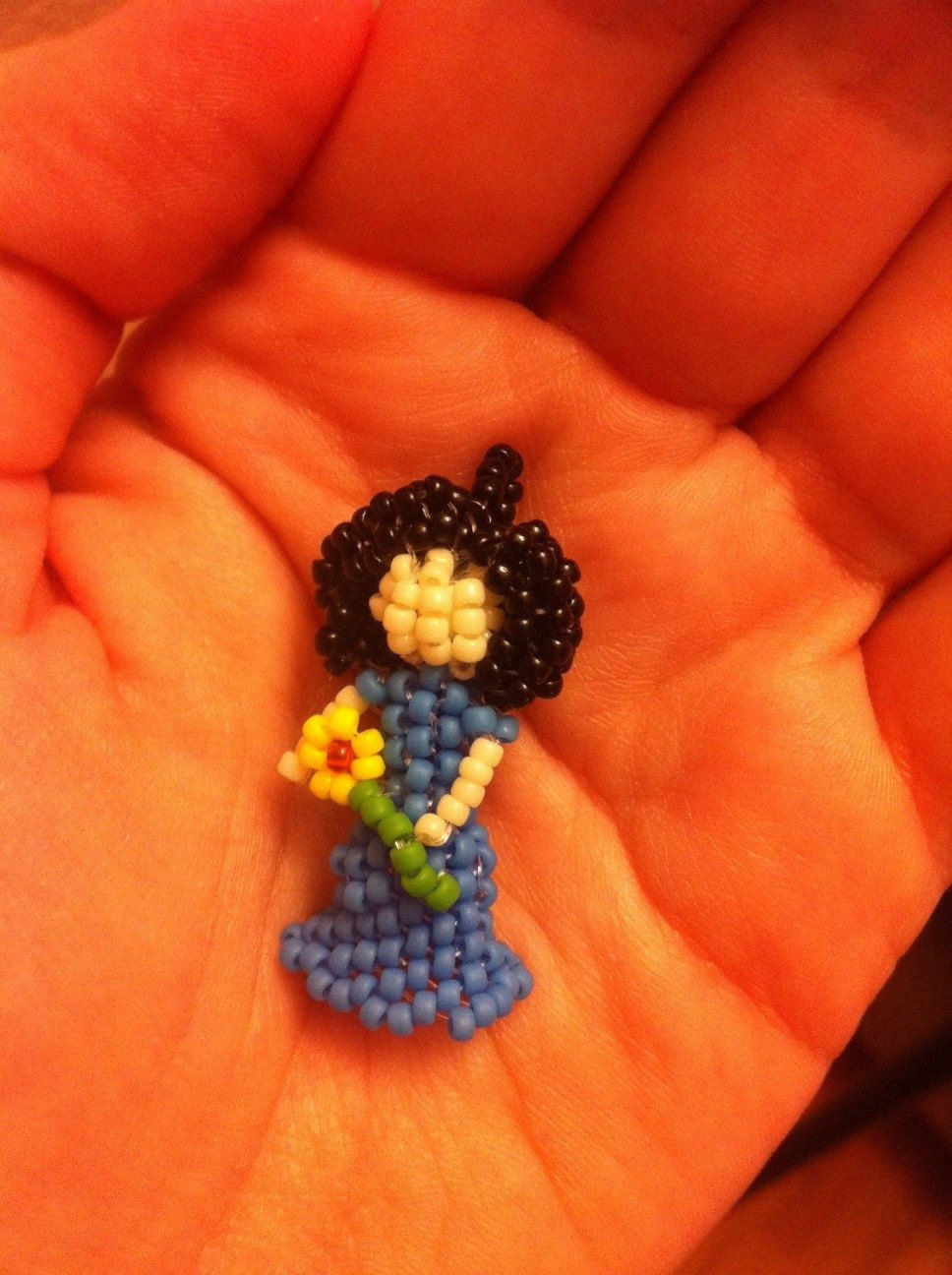 Seed Bead Girl Doll Pendant Choker Necklace with Blue Dress, Black Hair and a Yellow Flower Beaded Bead. $16.00, via Etsy.