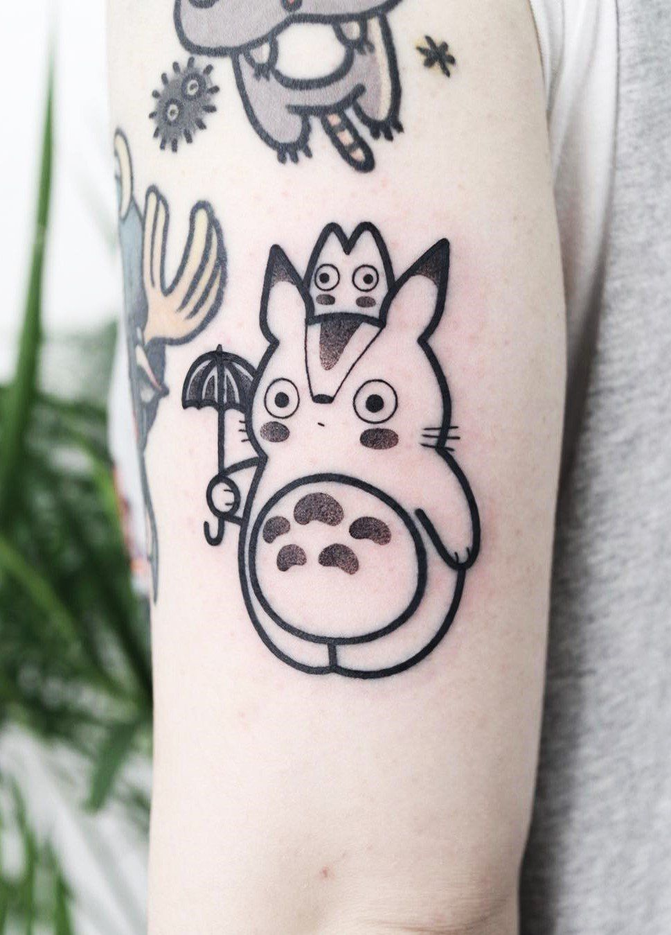 f1719e5f1 Check out these cute pop culture tattoos! Featuring anime tattoos such as  Princess Mononoke, My Neighbor Totoro, Howl's Moving Castle & Spirited Away.