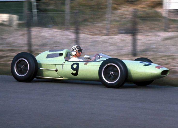 Innes Ireland in his BRP Lotus, with his distinctive checkerboard helmet.