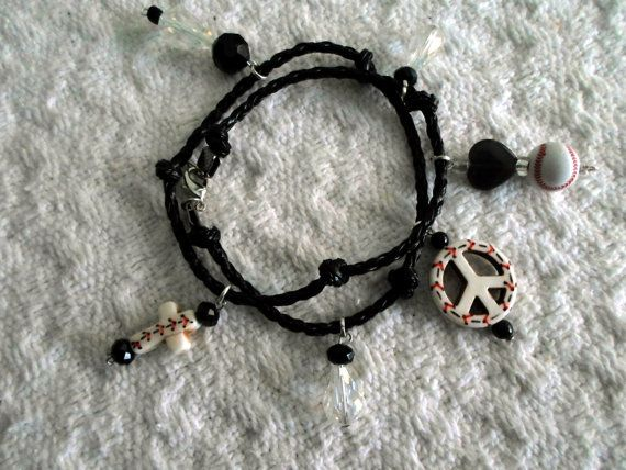"""This bracelet is approx. 14"""" long and wraps around twice. A braided Black leather cord with 6 handmade charms made from mezonite and shell beads surrounded by clear tear drop and black crystals. These can be done in what ever color combo you would like, this one is all baseball but you can also order sports combinations just contact me."""