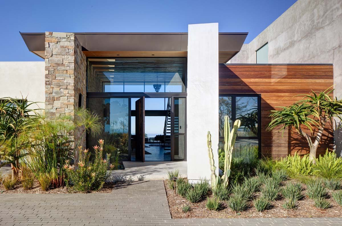 Modernist Stone And Wood Dwelling Offers Panoramic Pacific Ocean Views Stone Exterior Houses California Modern House Designs Exterior