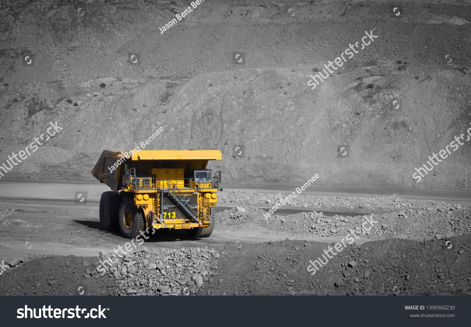 Spot color large yellow truck used in a modern coal mine