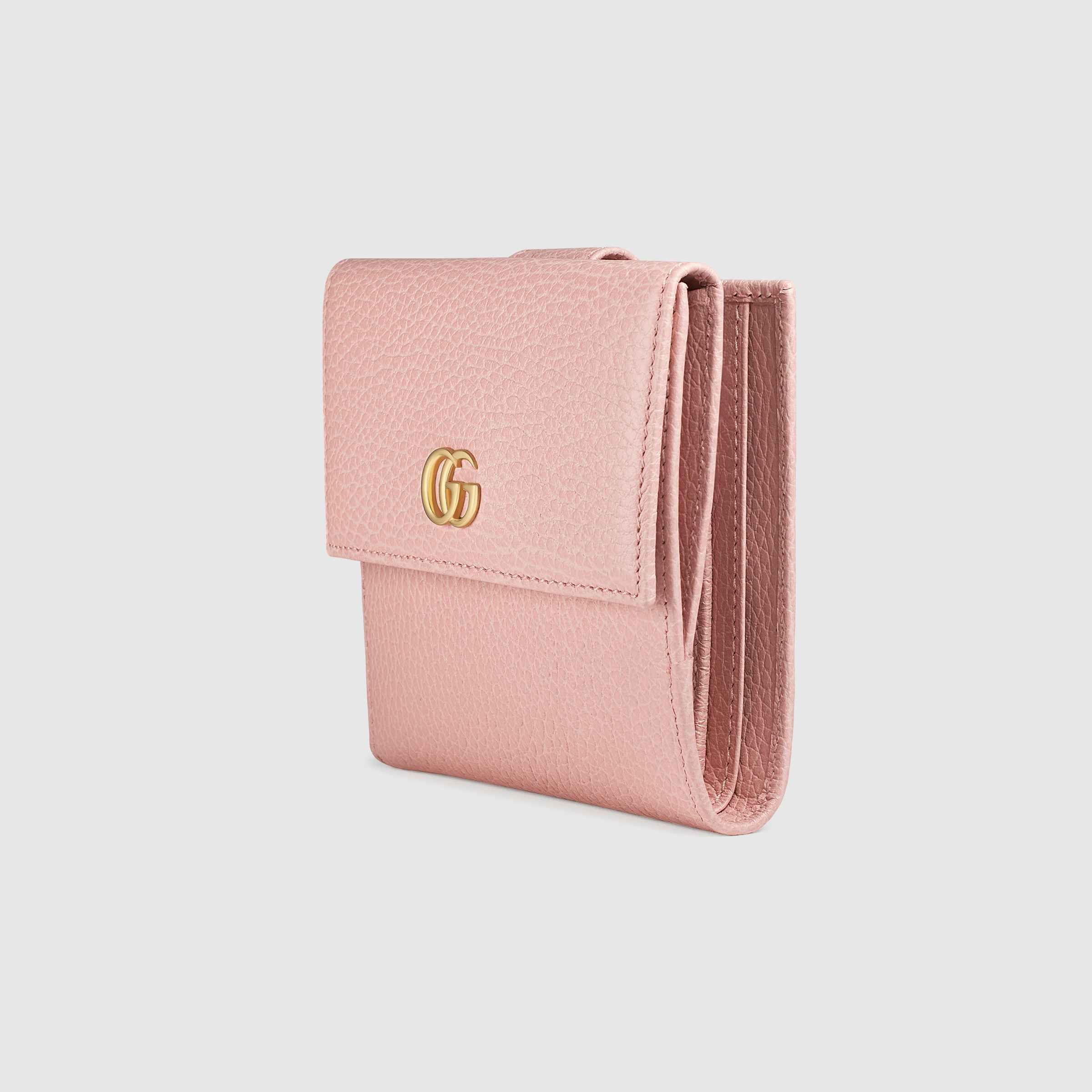 ca1fb127915c Shop the Leather french flap wallet by Gucci. A french flap wallet with  small Double G metal detail. Made in textured leather.