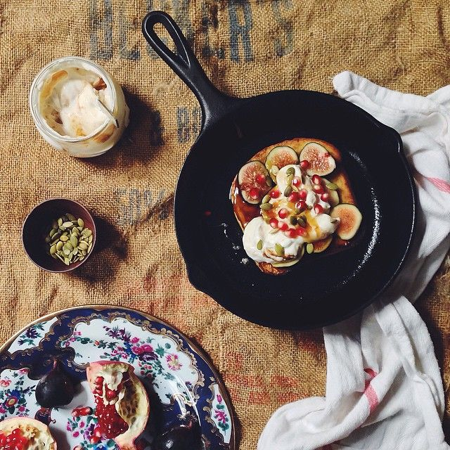 Fully-loaded pumpkin pie-spiced French toast topped with sliced figs, pomegranates, pumpkin seeds & date yogurt #thisisfall