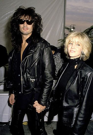 Classic rocker (and rocker girlfriend style), courtesy of Tommy Lee and Heather Locklear in 1990: black leather jacket, black everything else, and big hair.