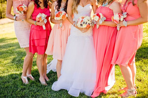 LOOK BRIDESMAIDS! Mix matched corals and pinks. This looks good! I would like to lean more toward pinks than towards orange. If you click on the picture and go to the actual website, i love the whole look - with gray suits and aqua colored ties :)