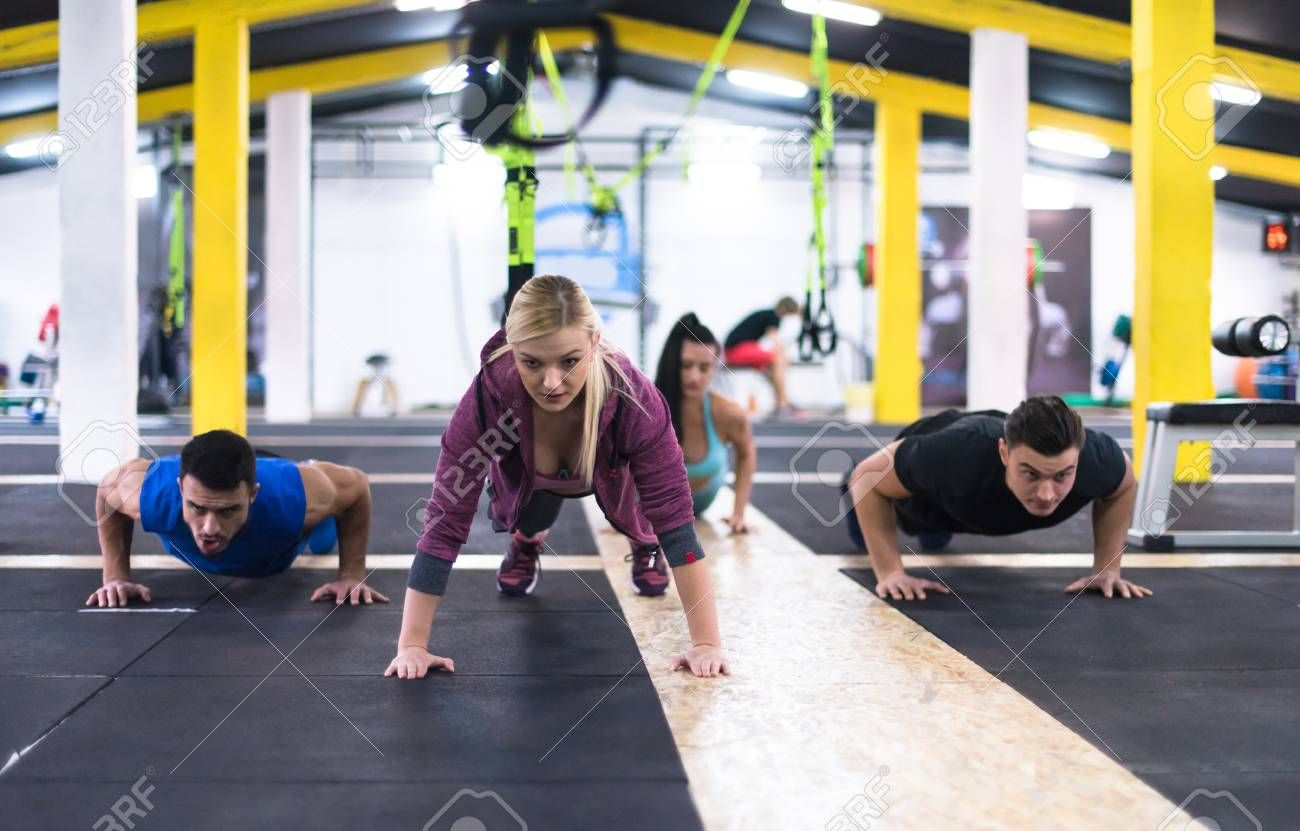 group of young healthy people doing pushups at cross fitness gym , #ad, #healthy, #people, #group, #...