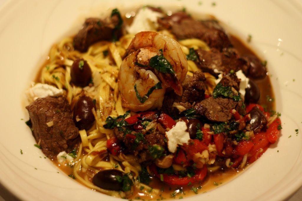 Steak & Shrimp-        Tenderloin tips, shrimp, basil,  roasted pepper, Kalamata olives,  goat cheese, linguini, x-tra virgin olive  oil & balsamic reduction