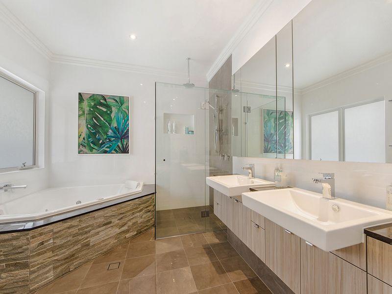 Master bathroom, corner spa bath, marble floors, marble bench top ...