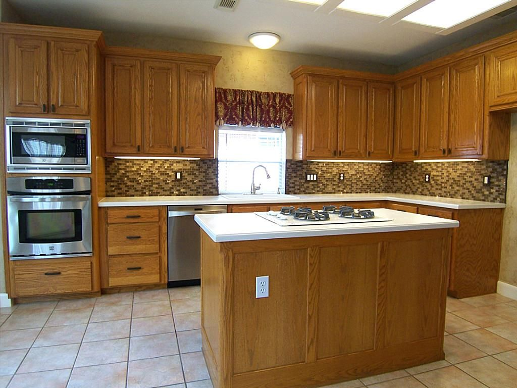 Rich Oak wood cabinets with raised panels and oil rub ...