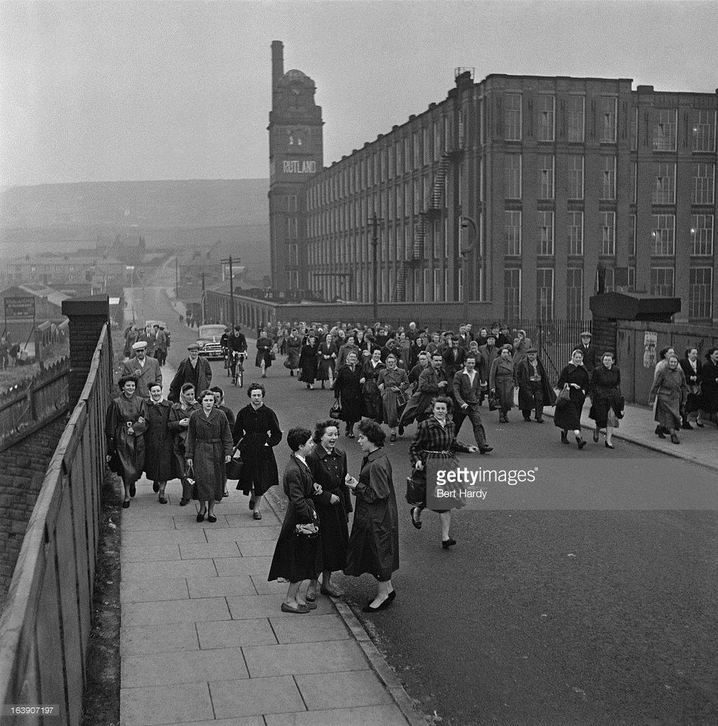 Workers leaving Rutland Mill, a cotton spinning mill in