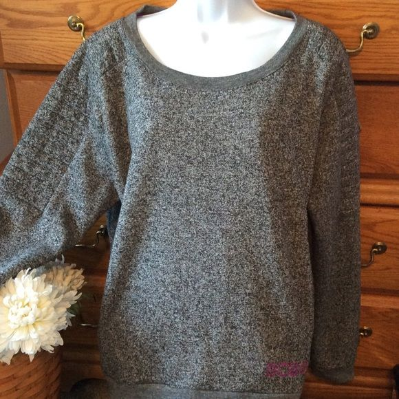"""BCBG Gray Sweat Shirt With Pink Bling NWOT 66% polyester and 34% cotton.  Excellent condition because it has never been wore.  Approximately  25"""" in length in the front and is a little longer in the back.  Has Pockets and is very soft and comfy inside. Has weight to it.  When measured flat armpit to armpit it is 23"""" across.  Tweed color look and has pink bling with the Letters BCBG on it. BCBGMaxAzria Tops Sweatshirts & Hoodies"""