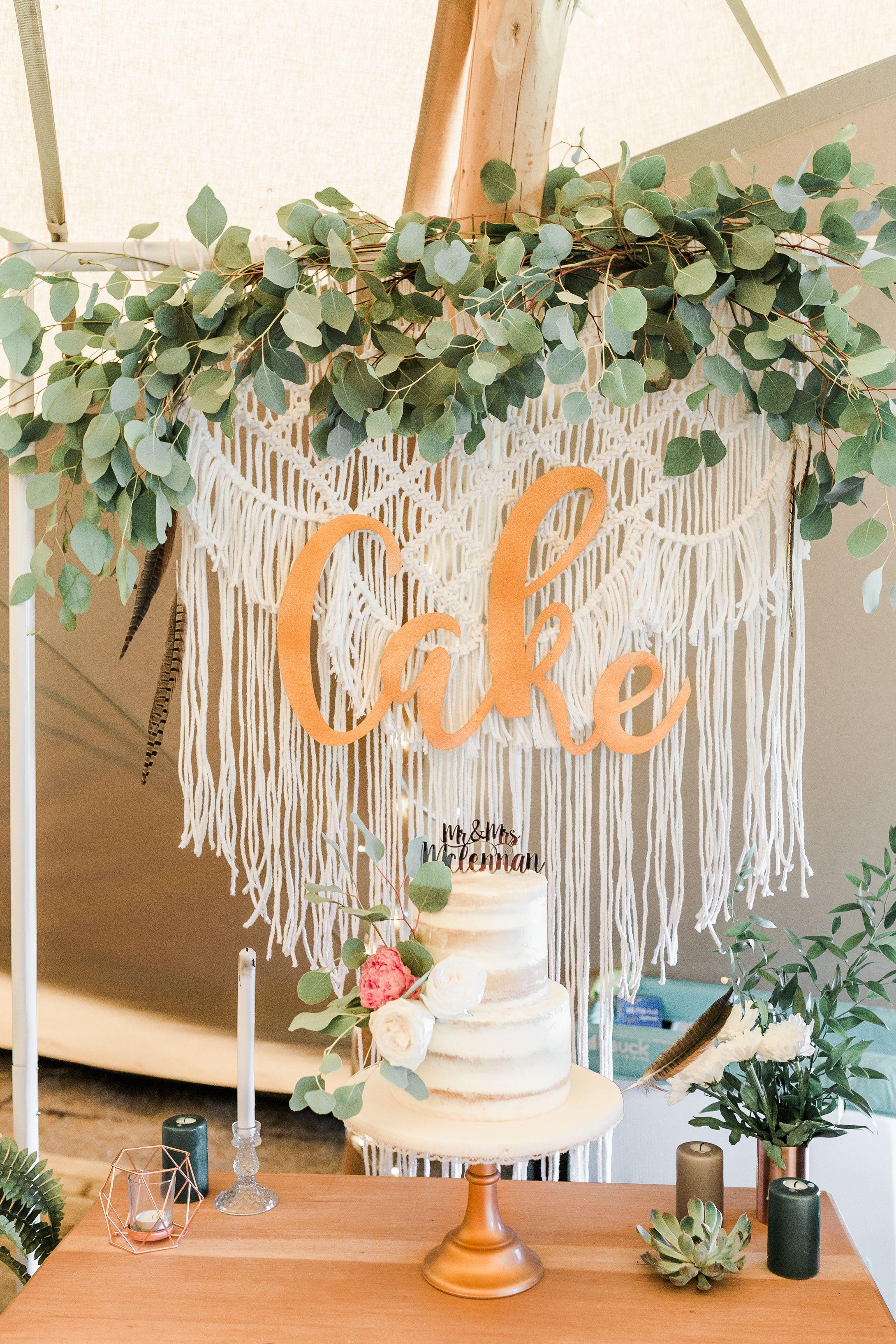 Boho botanical wedding cake backdrop with macrame wall
