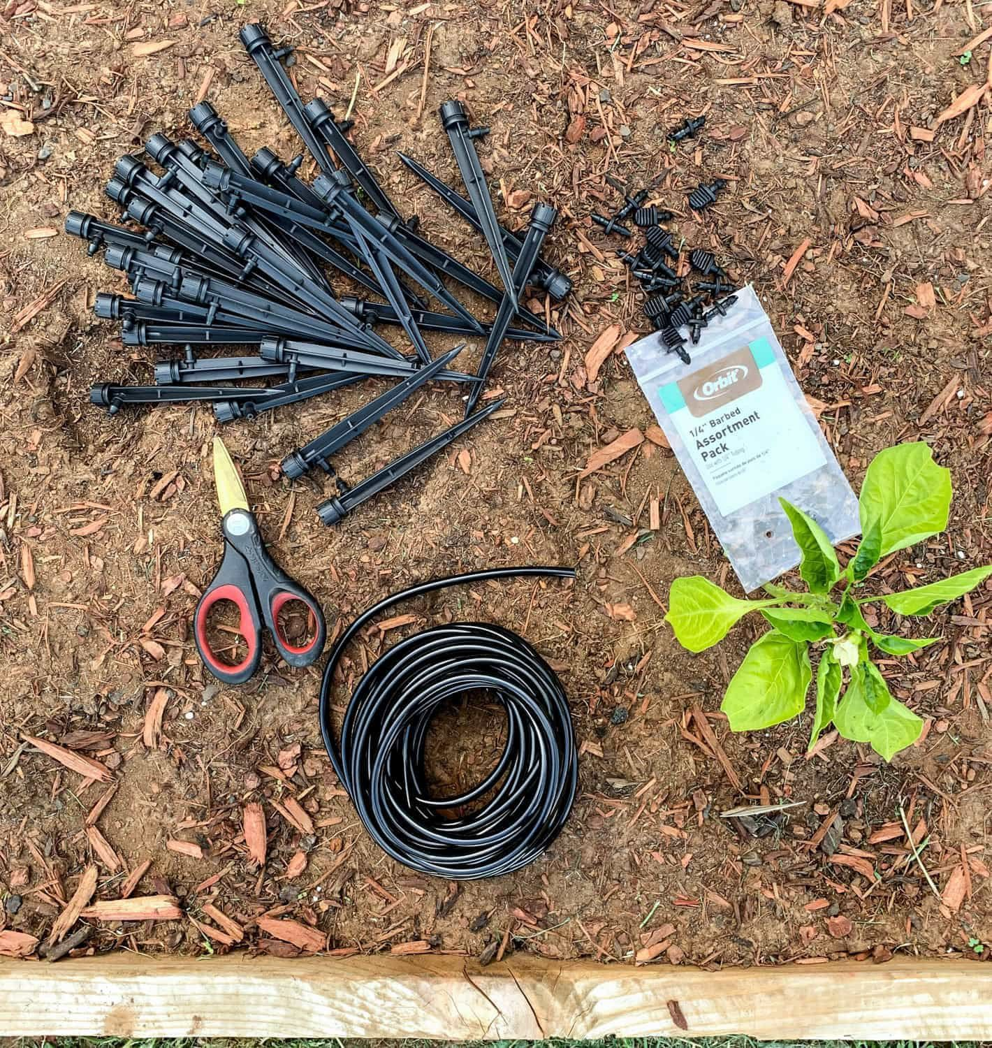 How To Install A Drip Irrigation System With Automatic Watering In 2020 Watering Raised Garden Beds Garden Watering System Drip Irrigation System