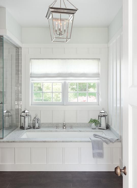 The perfect place to relax, this stunning cottage bathroom boasts a