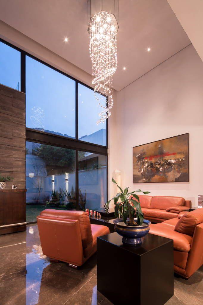 Busca imágenes de diseños de Salas estilo moderno}: Sala naranja. Encuentra las mejores fotos para inspirarte y y crear el hogar de tus sueños.