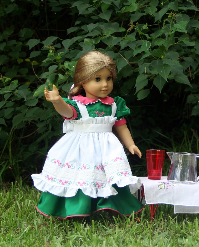 """Embroidered dress and apron for a 18"""" inch doll (American girl Elizabeth pcitured) dress by Stitching with Elli. Embroidery design by Thread n scissors https://stitchingwithelli.wordpress.com/2016/06/23/summer-party-for-the-dolls/"""